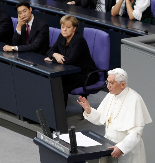 German Economy Minister Philipp Roesler and Chancellor Angela Merkel look on as Pope Benedict XVI gives a speech to the German parliament in Berlin Sept. 22. Pope Benedict began a four-day visit to his homeland. (CNS photo/Thomas Peter, Reuters) (Sept. 22, 2011) See GERMANY-ARRIVE (UPDATED) Sept. 22, 2011.