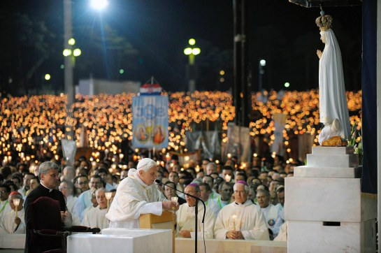Pope Benedict XVI prays in front of a statue of Our Lady of Fatima during a candlelight vigil at the Marian shrine of Fatima in central Portugal May 12. (CNS photo/L'Osservatore Romano via Reuters) (May 14, 2010) See PORTUGAL-WRAPUP May 14, 2010.