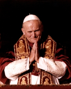 Newly elected Pope John Paul II -- Polish Cardinal Karol Wojtyla -- is pictured as he greets the world from the central balcony of St. Peter's Basilica Oct. 16, 1978. Blessed John Paul II and Blessed John XXIII will become saints April 27, the feast of the Divine Mercy, in a ceremony led by Pope Francis at the Vatican. (CNS photo/Catholic Press Photo) (Sept. 30, 2013) See JPII-JXXIII (UPDATED) Sept. 30, 2013.